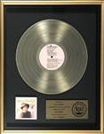 "RIAA Gold Record Award for Elvis Presleys 1971 LP <em>Elvis Country (""Im 10,000 Years Old"")</em> - Certified in 1977"